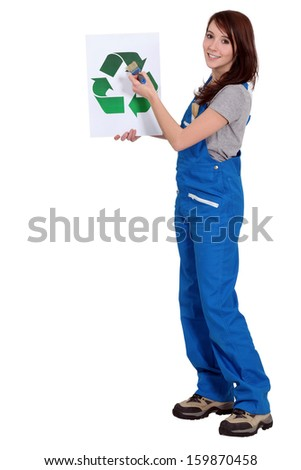 Female manual worker holding a sign.
