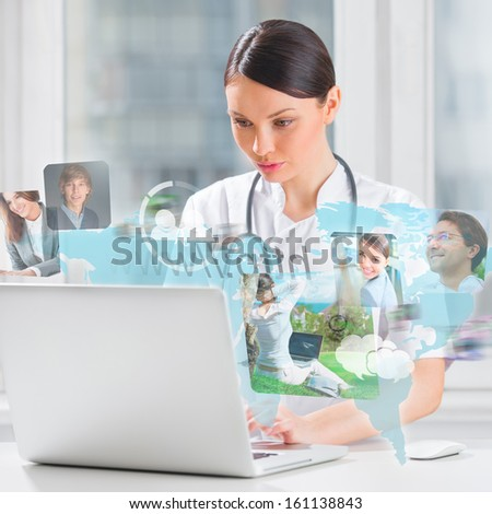 Female medical doctor surfing on web with modern laptop