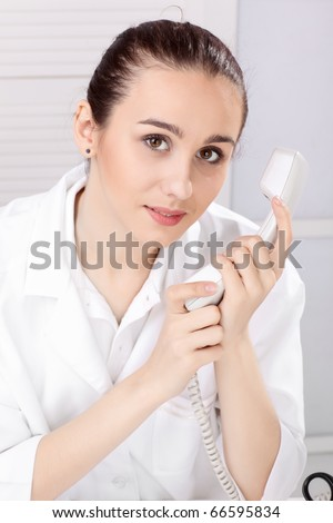 Female medical doctor working with a microscope