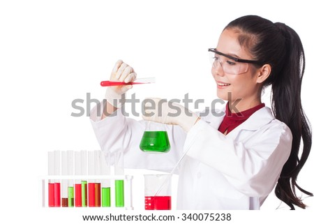 female medical or scientific researcher holding at a liquid solution in a lab. - stock photo