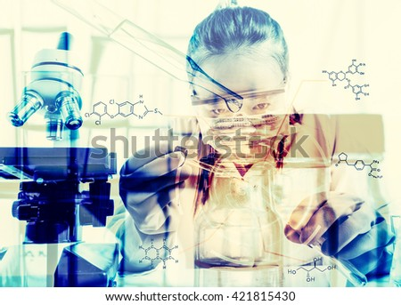 female medical or scientific researcher or woman doctor looking at a test tube of clear solution in a laboratory with her microscope beside her;Double exposure style - stock photo
