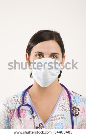 female medical professional wearing particle mask