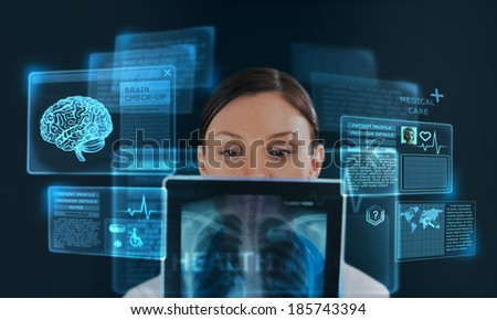 Female medicine doctor working with modern computer interface as concept - stock photo