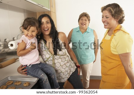 Female members of a family cooking together - stock photo