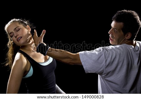 female MMA fighter fighting a man - stock photo
