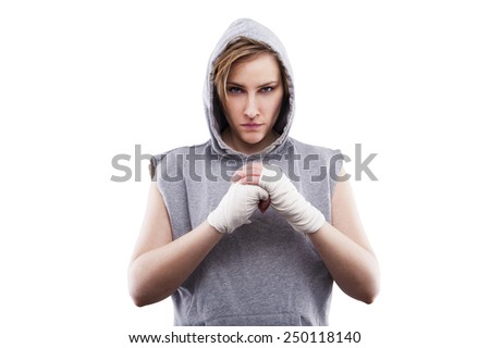 female MMA fighter in a black background - stock photo