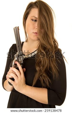 Female model holding gun hair in face - stock photo