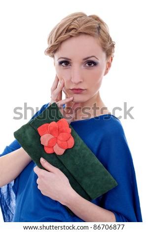 Female Model holding purse posing on a white background - stock photo