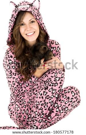 female model holding stuffed animal in pajamas - stock photo