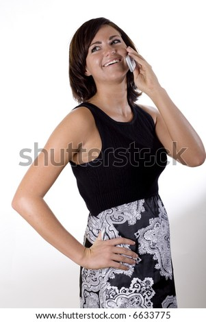 Female model in a black tank top and skirt on a cell phone