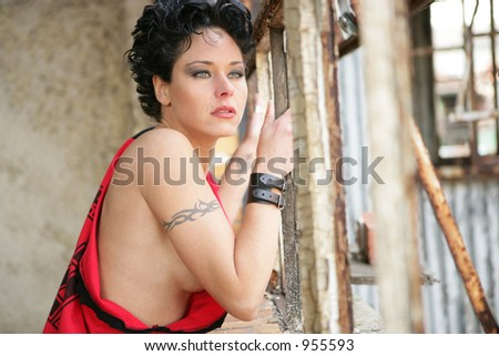 Female Model in Torn T Shirt at Window - stock photo