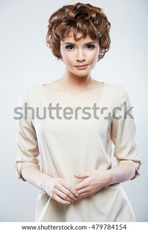 Female model portrait. Young woman using hands for posing.