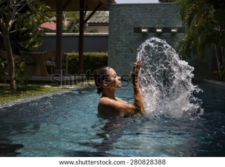female model posing by the pool, outdoor portrait
