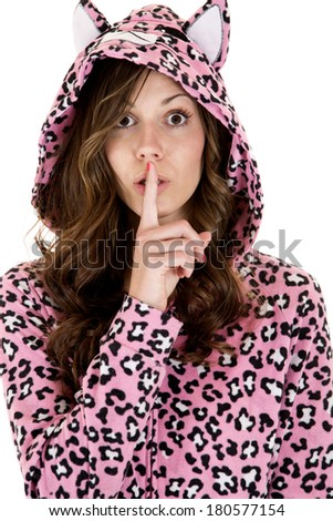 female model wearing pajamas finger to mouth - stock photo