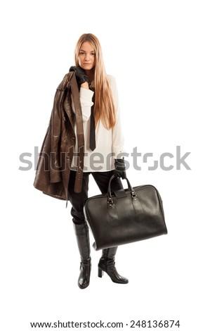 Female model with leather jacket and black handbag posing isolated on white studio background - stock photo