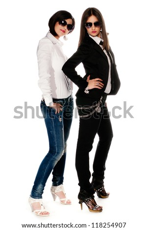 Female models dressed up in studio isolated on white