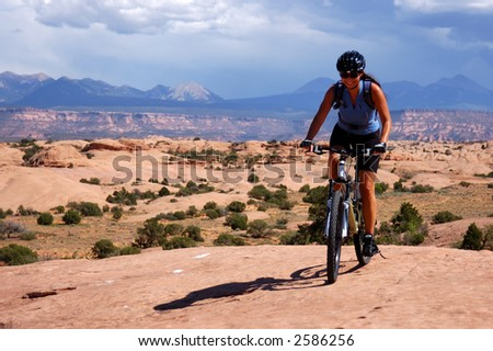 Female mountain biker - stock photo