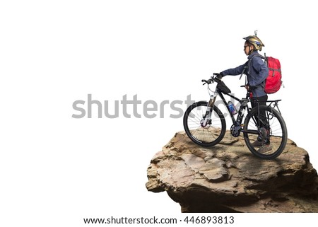 Female mountain biker on bicycle standing at edge of rock, isolated on white background