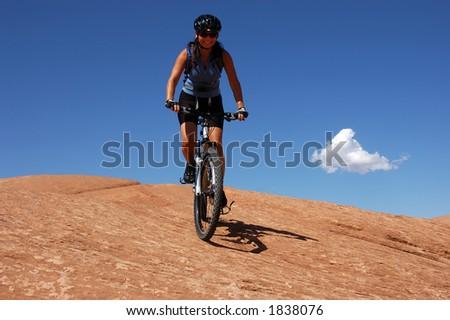 Female mountain biker on slick rock - stock photo