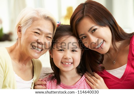 Female Multi Genenration Chinese Family Group Relaxing At HomeTogether - stock photo