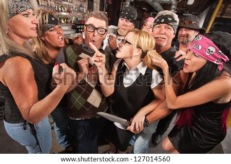 Female nerd with husband confronting biker gang thugs in bar