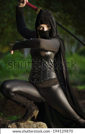 Female ninja in battle - stock photo