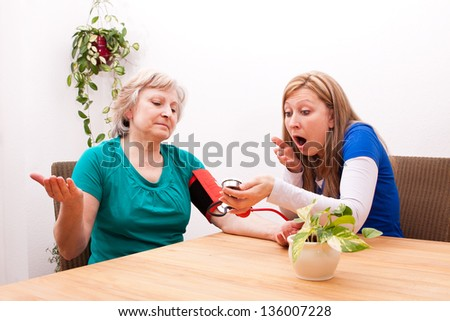 female Nurse and patient are surprised by the blood pressure - stock photo