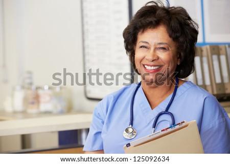 Female Nurse At Nurses Station - stock photo