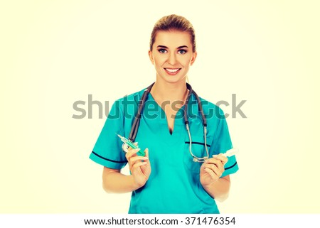 Female nurse or doctor preparing an injection - stock photo