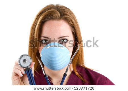 Female nurse wearing scrubs and a surgical mask holds a stethoscope.