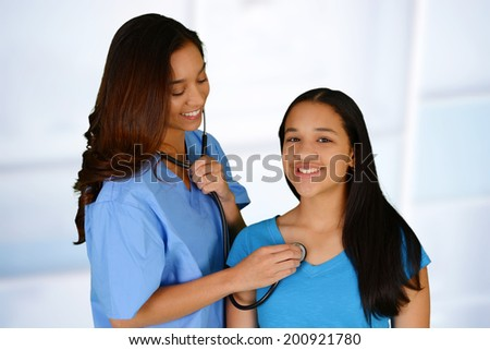 Female nurse working her job in a hospital - stock photo