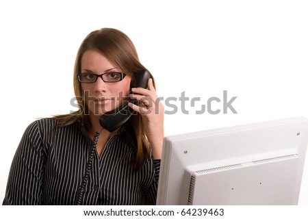 Female office worker on phone with computer