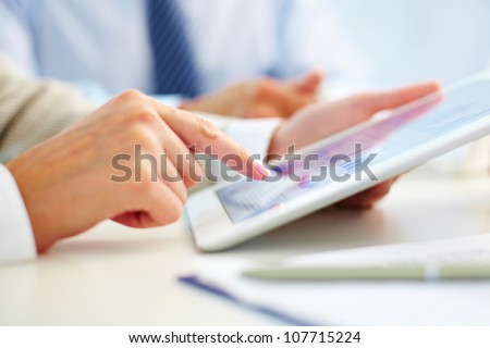 Female office worker using touchpad - stock photo