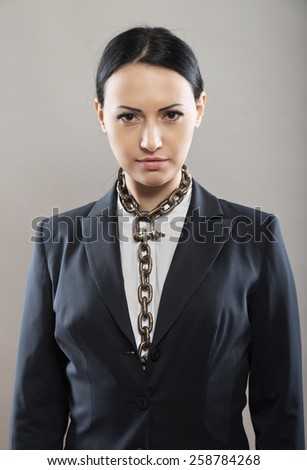 Female office worker with chain tie, concept - stock photo