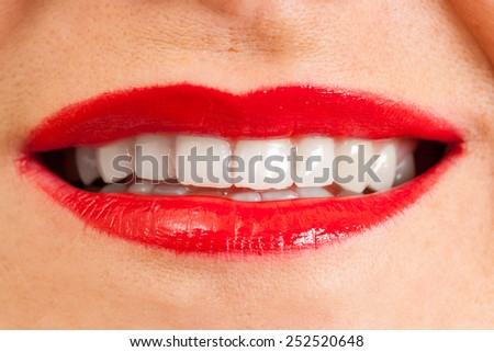 female open lips with applied red lipstick, white teeth - stock photo