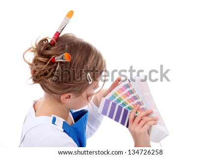 female painter holding colour chart - stock photo