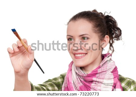 Female painter isolated over white background. Focus in hand with paint brush.