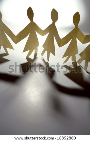 Female paper-chain holding hands
