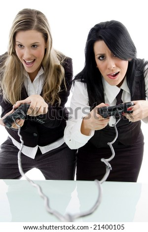 female partners playing game and holding remote against white background - stock photo