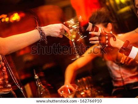 Female party in the night club - stock photo