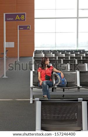 Female passenger waiting for your flight  - stock photo