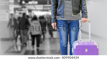 female passenger  with suitcase.
