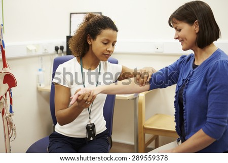 Female Patient Having Physiotherapy In Hospital - stock photo