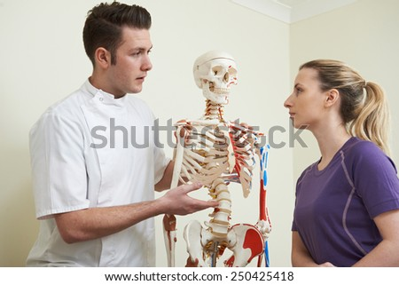 Female Patient In Consultation With Osteopath - stock photo