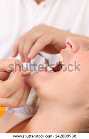 Female patient with dentist in a dental treatment - stock photo