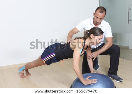 female patient with physical therapist  - stock photo