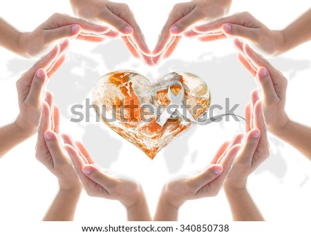 Female people hands in heart shaped protecting orange color globe with white ribbon: Orange the World: End Violence against Women and Girls concept campaign: Elements of this image furnished by NASA  - stock photo