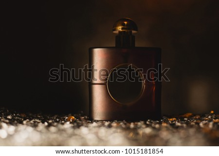 female perfume over dark