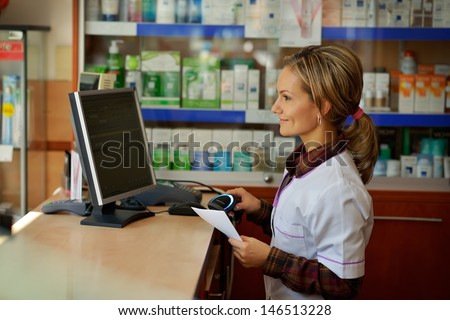 female pharmacist holding prescription - stock photo