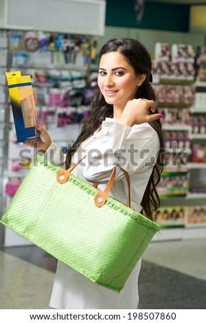 Female pharmacist in drugstore   - stock photo